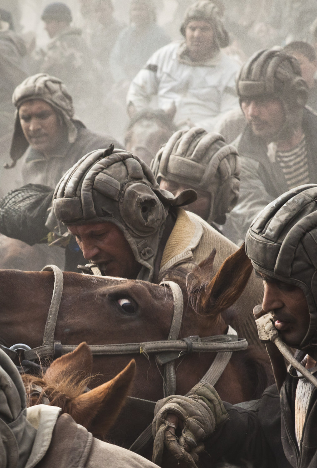 Buzkashi players fight for possession of a goat carcass in Sharinav, Tajikistan.