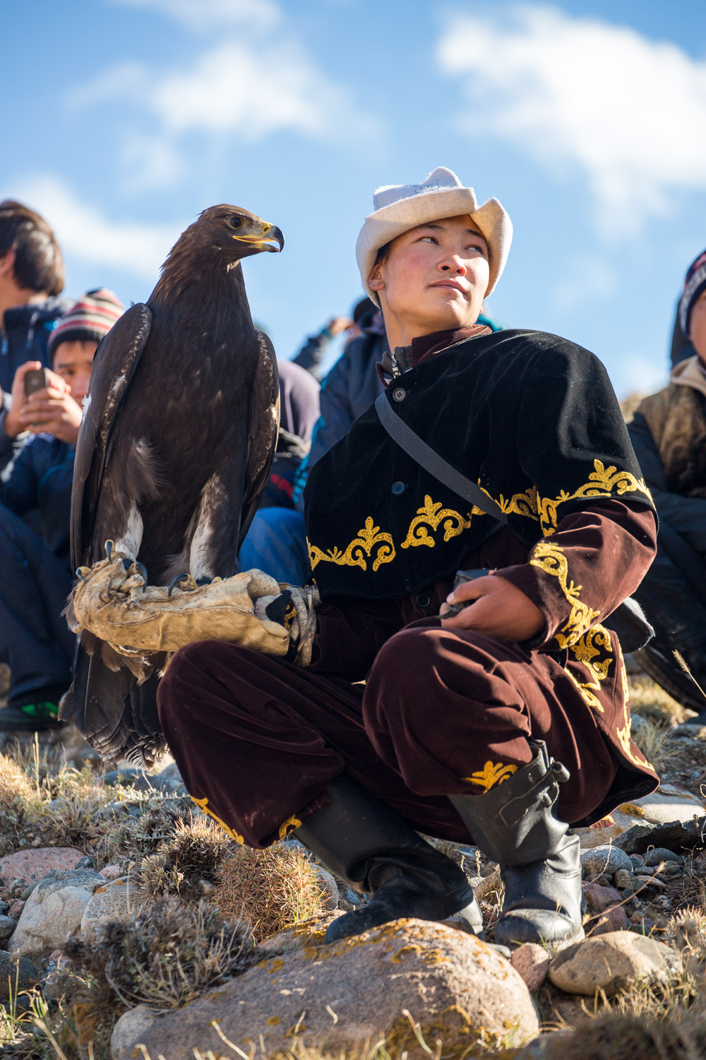 Young eagle hunter near Issyk Kul, Kyrgyzstan
