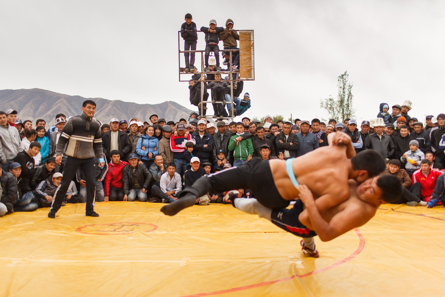Kyrgyz wrestlers at a village celebration in Ak Bulak, eastern Kyrgyzstan