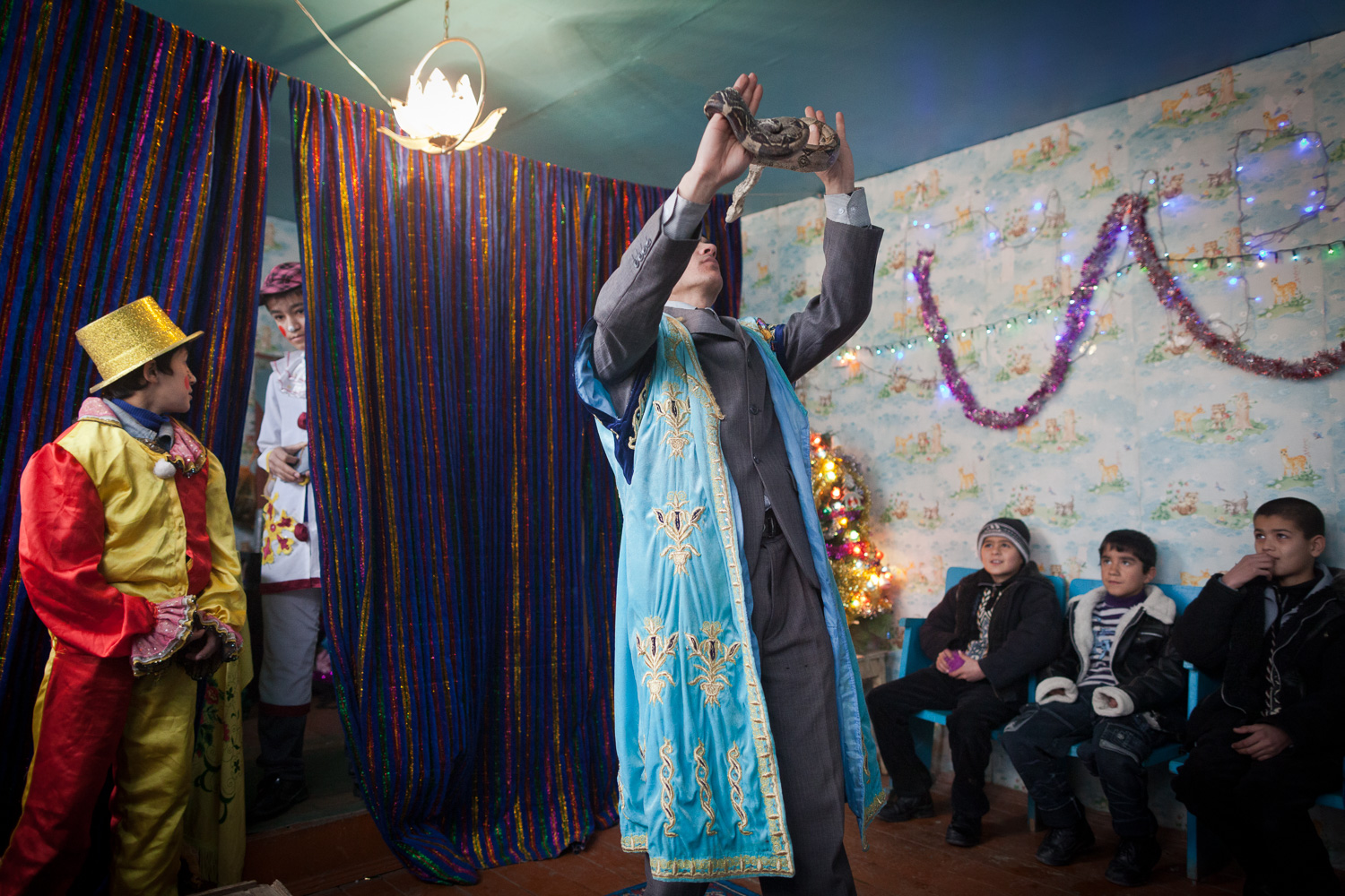 A magician in a makeshift circus in Dushanbe, Tajikistan