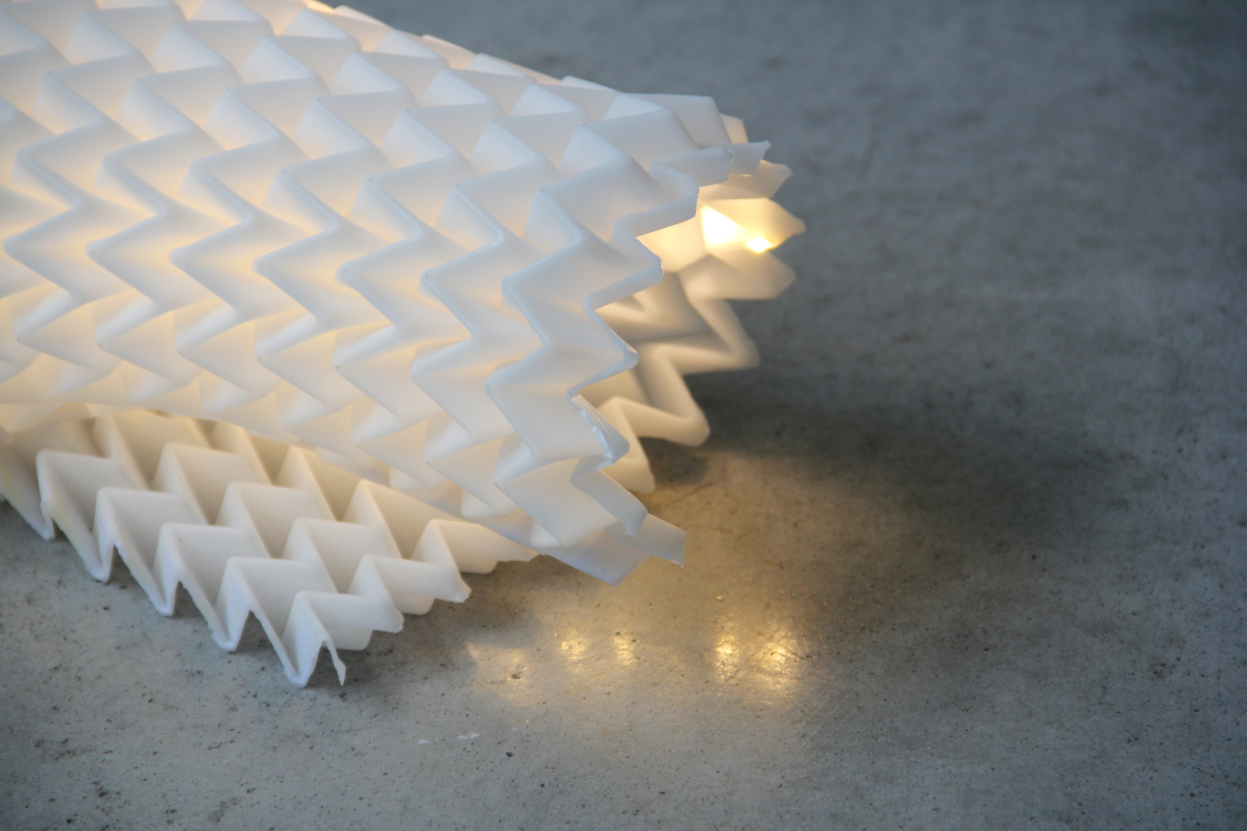 A research study in molding electronics and lights into the flexible orimetric structure.