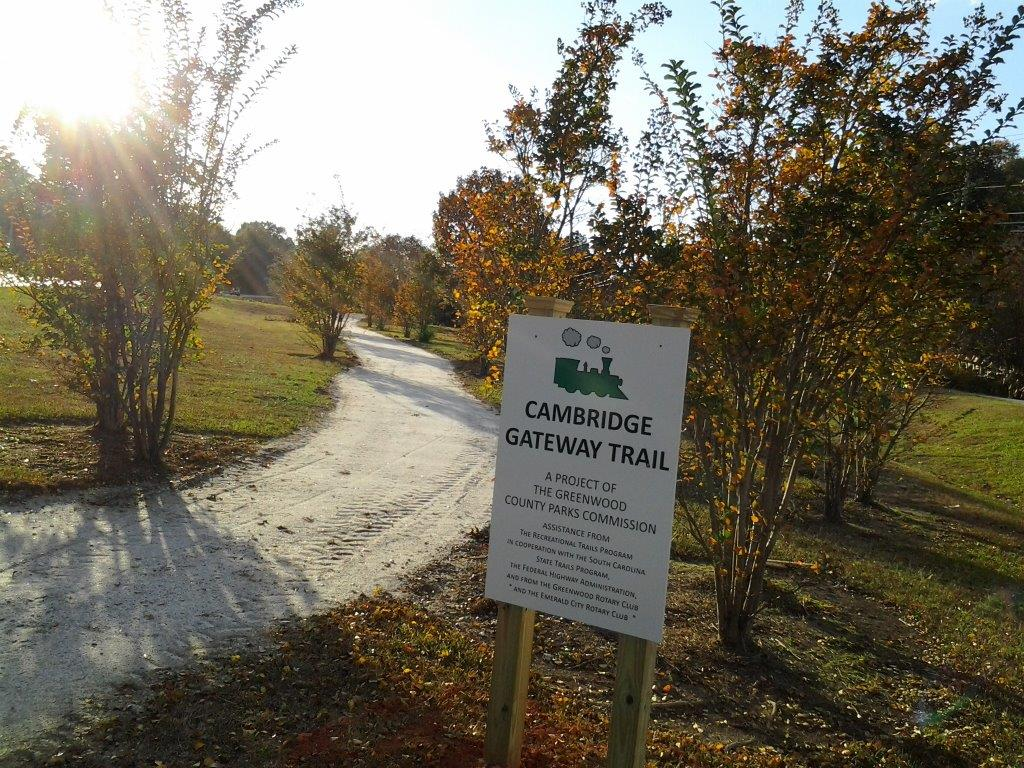 Cambridge Gateway Trail in Greenwood is 1 mile long and runs between the Greenwood Country Club and the American Legion Building. The Trail runs from the West Cambridge Park to the Bypass along Cambridge Avenue. The Trail is nicely landscaped, lined with rock dust, and has good signage.
