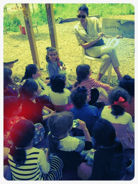 Karen Rester reads to children from a local yeshiva