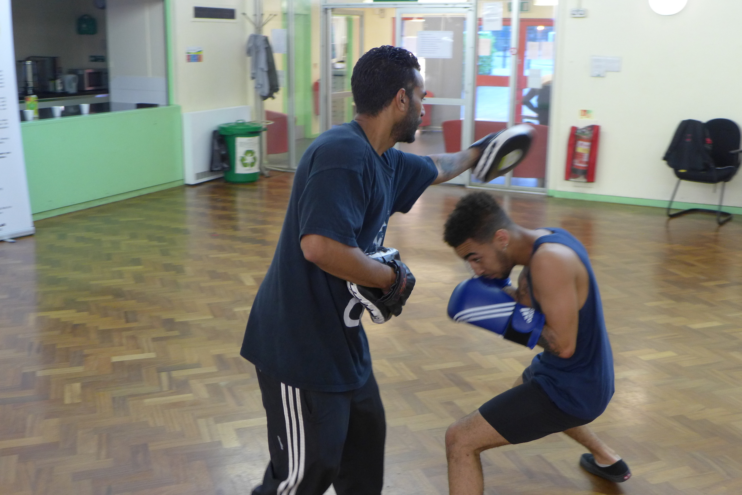 Student sparring with Boxing Trainer