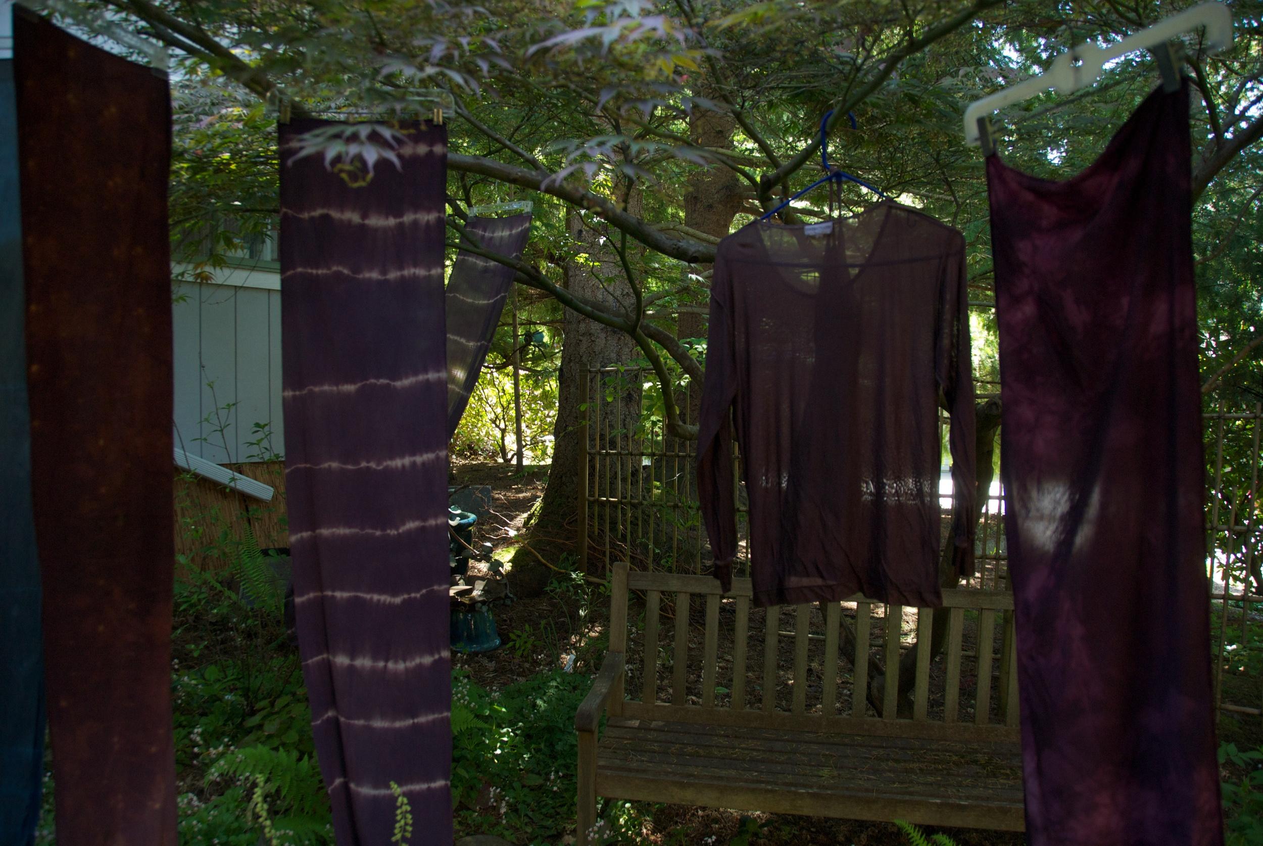 Shibori dyed garments hanging to dry