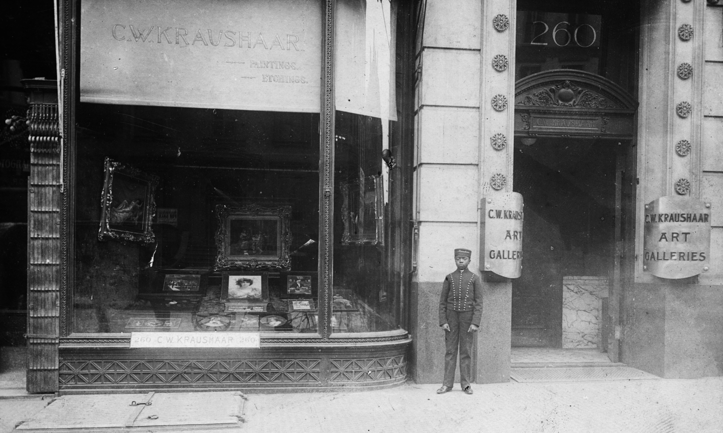 Photograph of boy standing in front of 260 Fifth Avenue, Kraushaar Art Galleries