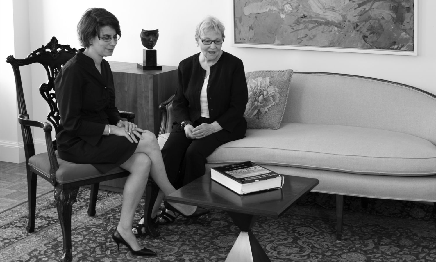 Photograph of Katherine Degn and Carole Pesner sitting, 74 East 79th Street, 2010