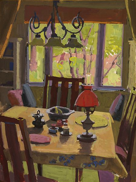 Table with large window and lamp with bright red shade
