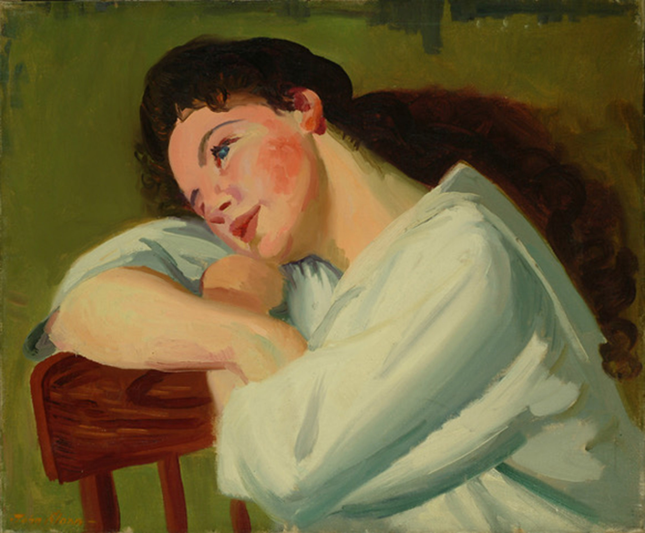 Portrait of a young woman resting her head on the back of a chair.