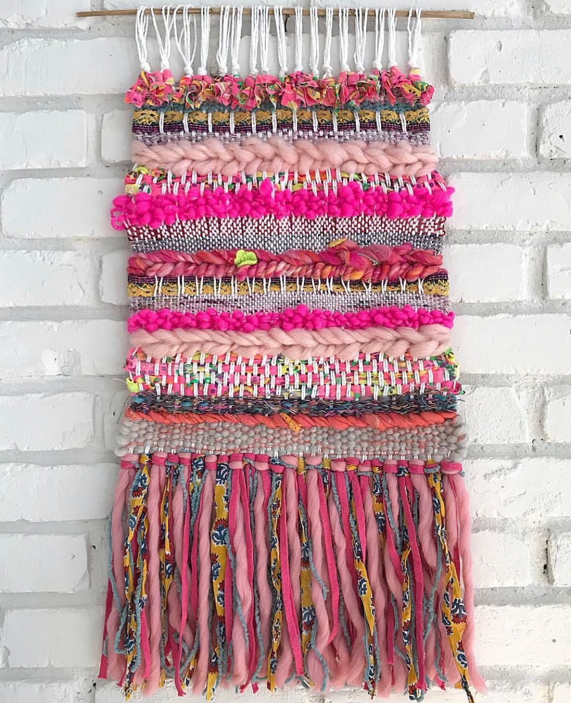 Pink woven tapestry made out of wool and cotton