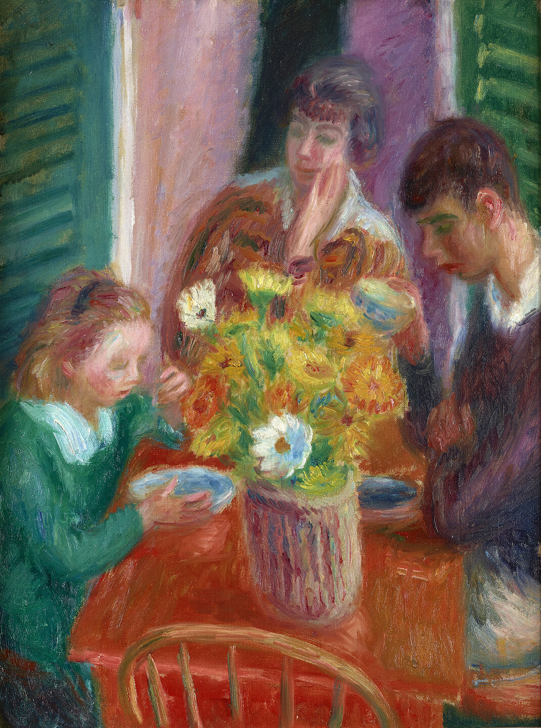Image of three figures seated at a table on a porch. Yellow bouquet of flowers in center