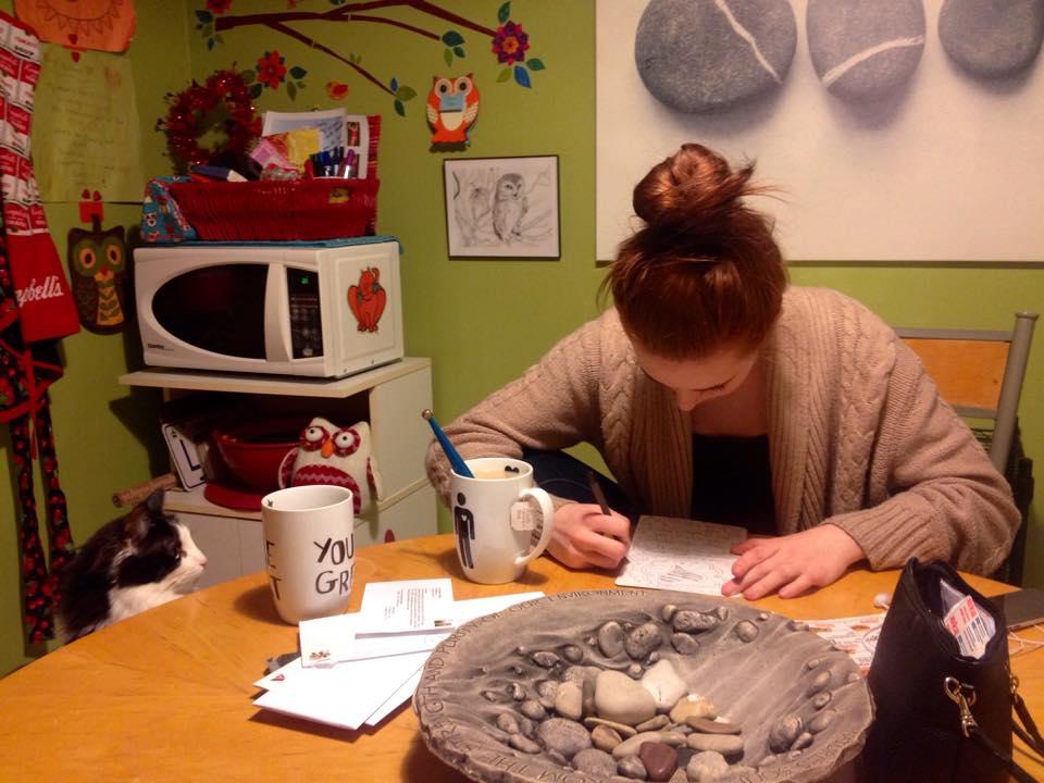 Chloe intently watching Paige create.