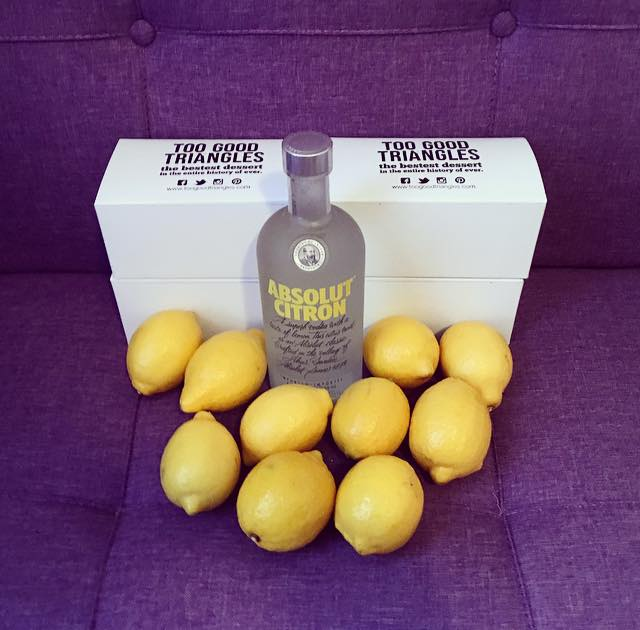 Provisions. This is how I potluck. Can't go wrong with vodka, lemons and Too Good Triangles!