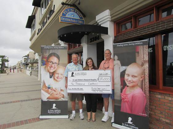 Owners Rick and Steve Loomis w  ith Shannon O'Nale of   St. Jude Children's Research Hospital