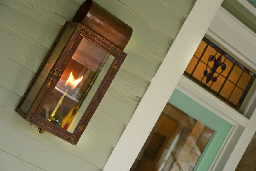 The gas lantern would have been the only source of light in the early 1900s when this home was built. Thus, it had to go back on the home. Just one of many details Balustrade Properties uses to enhance a front porch.