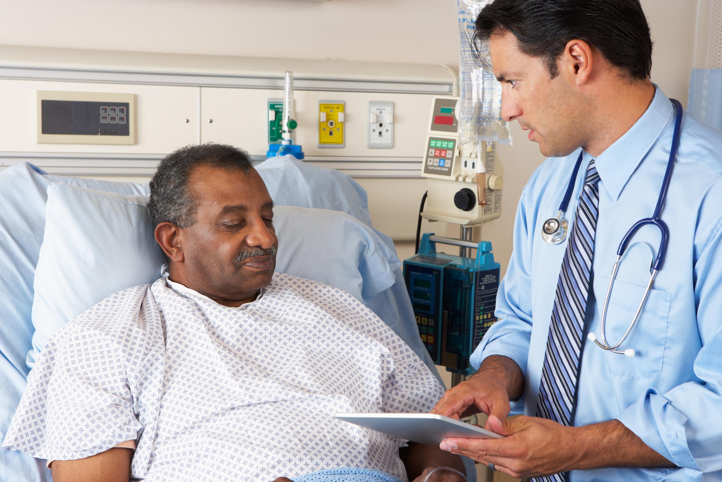 doctor treats patient hospital