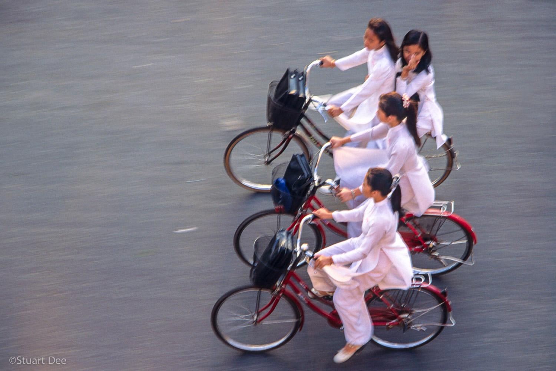 Girls on bikes, Ho Chi Minh City, Vietnam