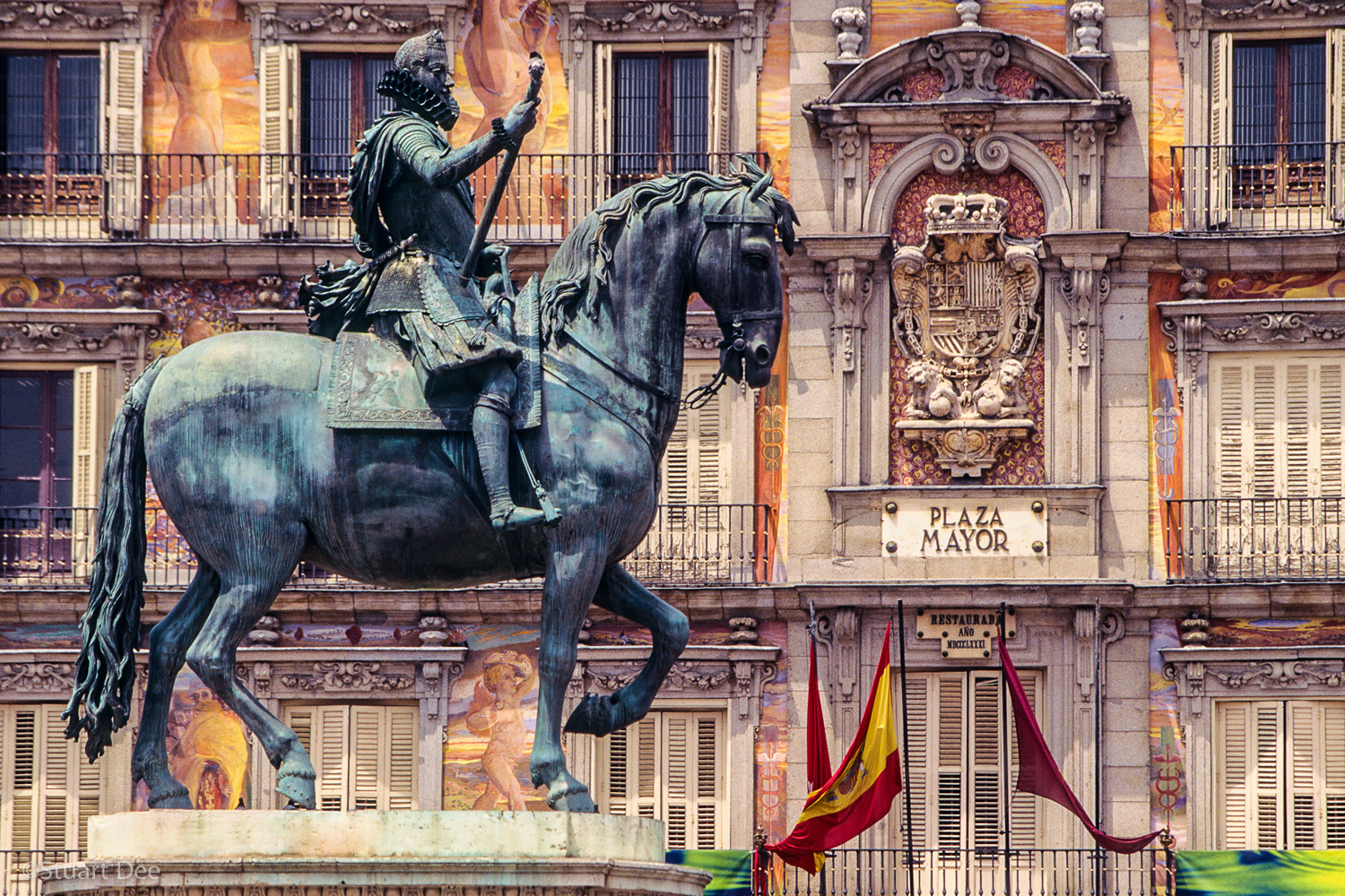 Plaza Mayor, showing equestrian statue of King Philip III (Felipe III) and colorful facade, Madrid, Spain. Plaza Mayor is one of the landmarks of Madrid.