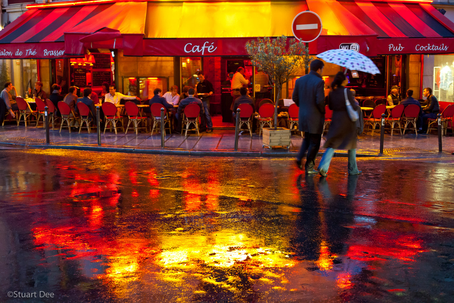 Cafe scene with wet streets an night, Paris, France