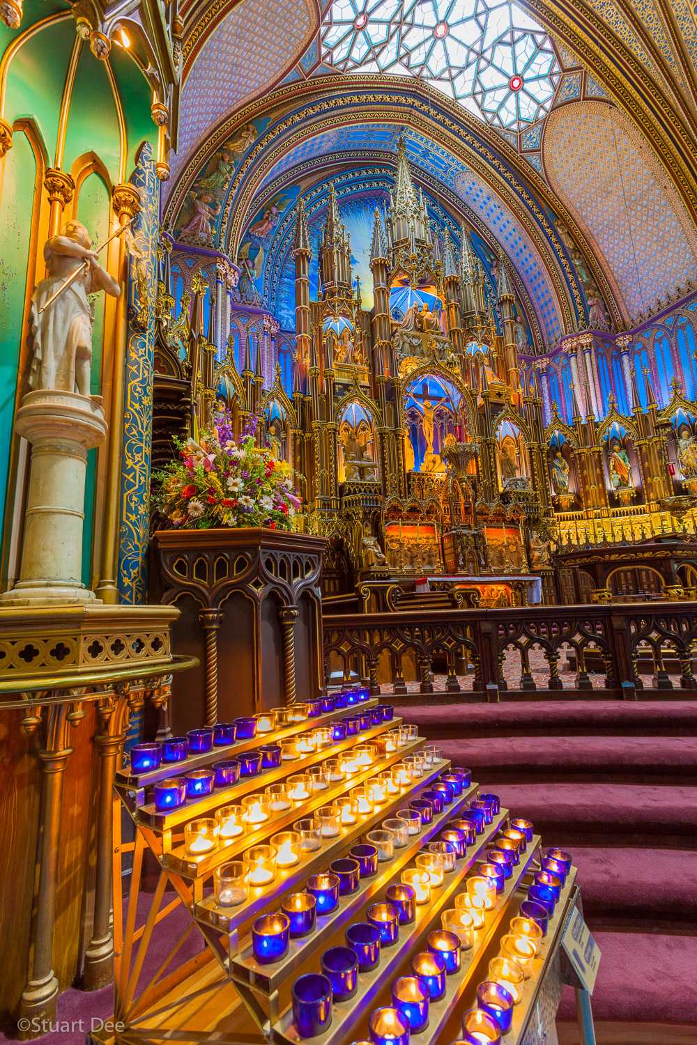 Votive candles and altar, Notre-Dame Basilica, Old Montreal, Montreal, Quebec, Canada. The church is one of the best known  landmarks and symbols of Montreal.