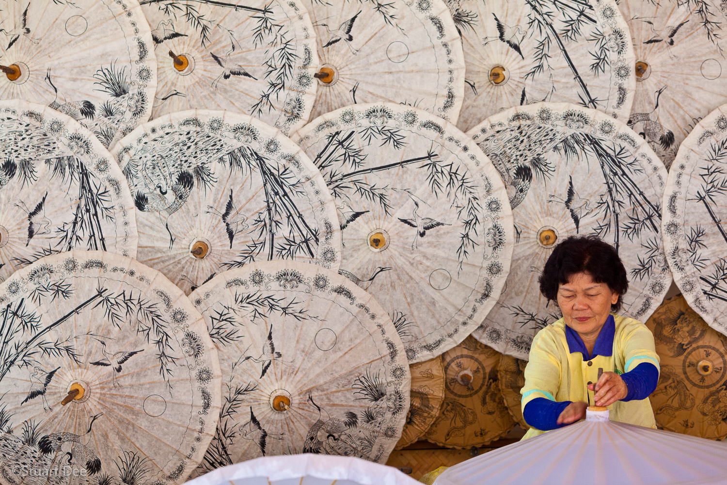 Woman making umbrellas, Chiang Mai, Thailand. Chiang Mai is known for umbrella-making.