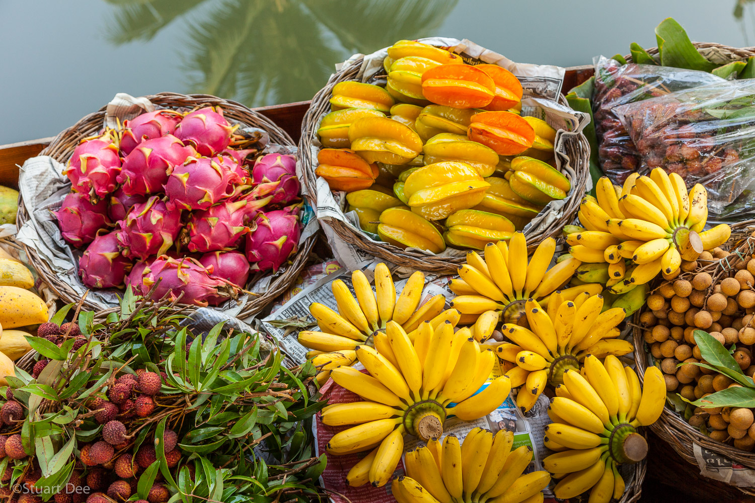 Fresh tropical fruit for sale from boat, floating market, Damnoen Saduak, Ratchaburi, Thailand