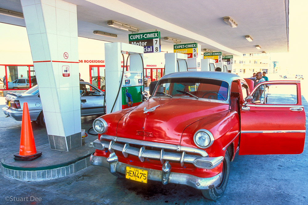 Vintage American car at gas station, Havana, Cuba