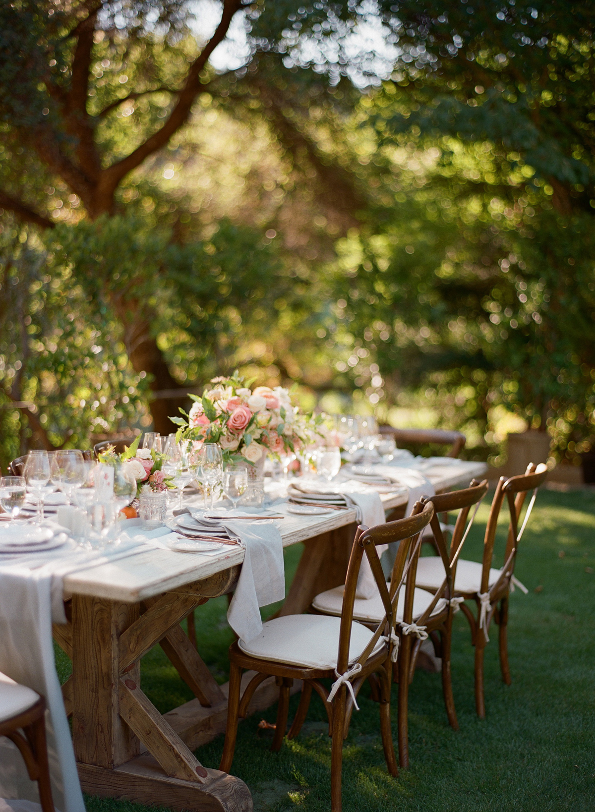 Photography by Christina McNeill.   When I see this photo it's hard to fathom that it was over 105 degrees at Meadowood that day.  To combat the heat, we had to continuously mist the flowers.  Only at the last minute were we able to set the table.  I know it wasn't what Hailey the planner wanted or planned.  But sometimes we have to forego our own plans so that the guest experience and the flowers look their best for the couple and their many guests.   I knew that it was too hot to set the arrangements in direct heat when it was so incredibly blistering hot that even a garland of lemon leaf was starting to get crisp and browning.  Sometimes with experience,  it's a judgment that you make because you want the flowers to look their best when guests walk into the reception space instead of doing it for the editorial shot.