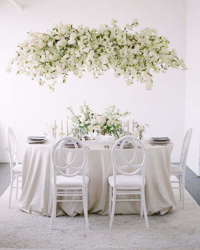 Blanco || All white seems something overdone but to me its nothing less than timeless and elegant plus who doesn't love sitting under a cloud of cherry blossoms?  And though simple, let me tell you doing all white is anything but. Thanks to these great vendors who each gave of themselves to create this magical all white table design . . .  Floral and event design: @nancyliuchin  Styling @creativeflowco  Photography @kevinchinphotog  Gowns  @sfbridalgalleria @inesdisanto @moniquelhuillierbride  Hair and makeup @pmastyle.maria  Models @maitekuyasin, @thi.buhlmann, @gotoyomat  Paper products @underwoodletterpress  Linens @latavolalinen  Rentals @hensleyeventresources  Cake @aspoonfulofsugarcakes