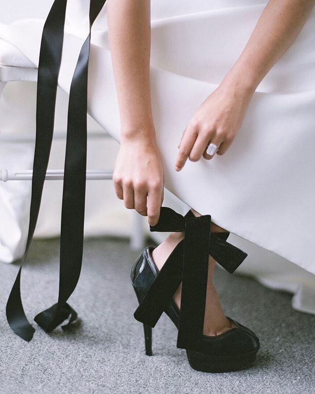 Black Tie Elegance || Who doesn't love a Good shoe shot! Add a touch of Black ribbon to a black high heel and your bridal gown ensemble is suddenly anything but boring!  Floral and event design: @nancyliuchin  Styling @creativeflowco  Photography @kevinchinphotog  Gowns  @sfbridalgalleria @inesdisanto  Hair and makeup @pmastyle.maria  Models @maitekuyasin, @thi.buhlmann, @gotoyomat  Paper products @underwoodletterpress  Linens @latavolalinen  Rentals @hensleyeventresources  Cake @aspoonfulofsugarcakes
