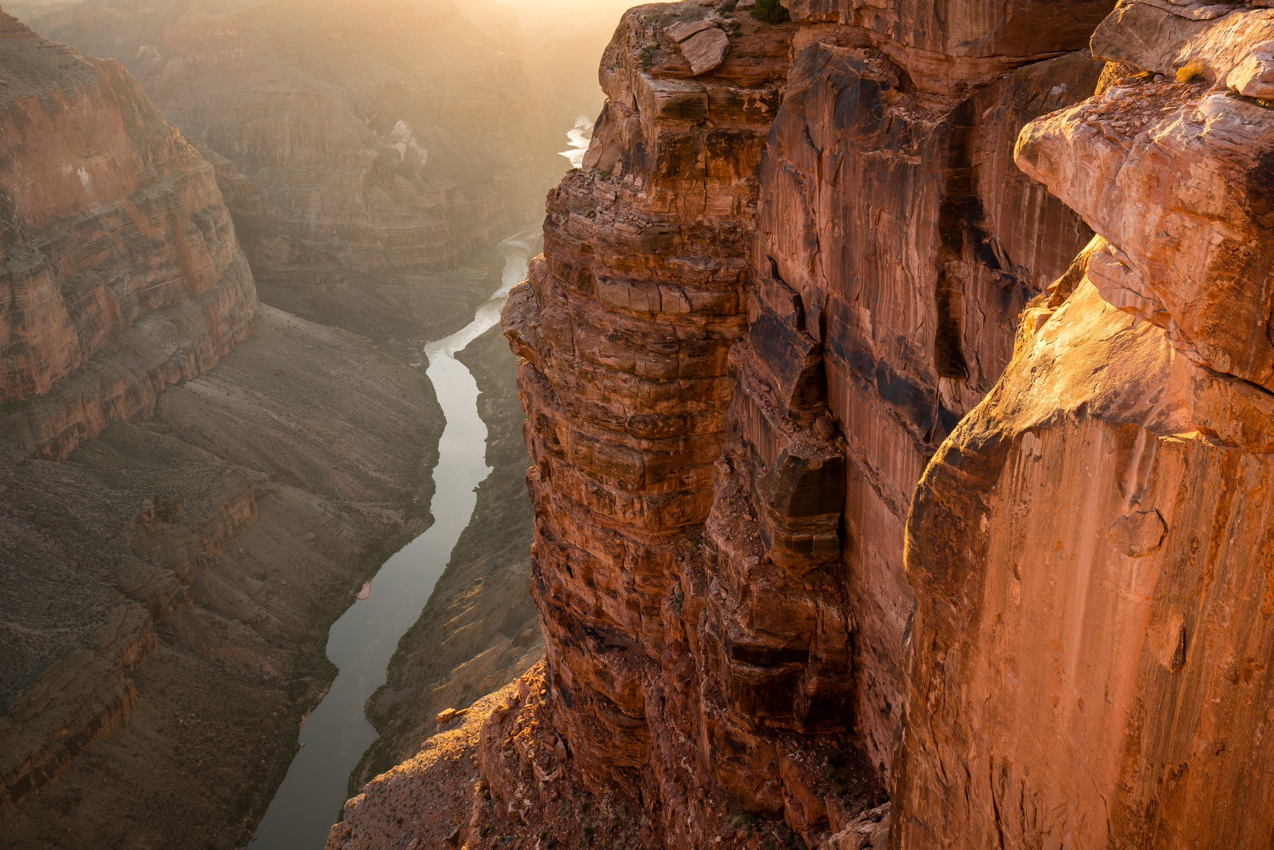 Landscape: Sunset over the Colorado River as it continues to carve deeper into the sandstone of the Grand Canyon, Grand Canyon National Park