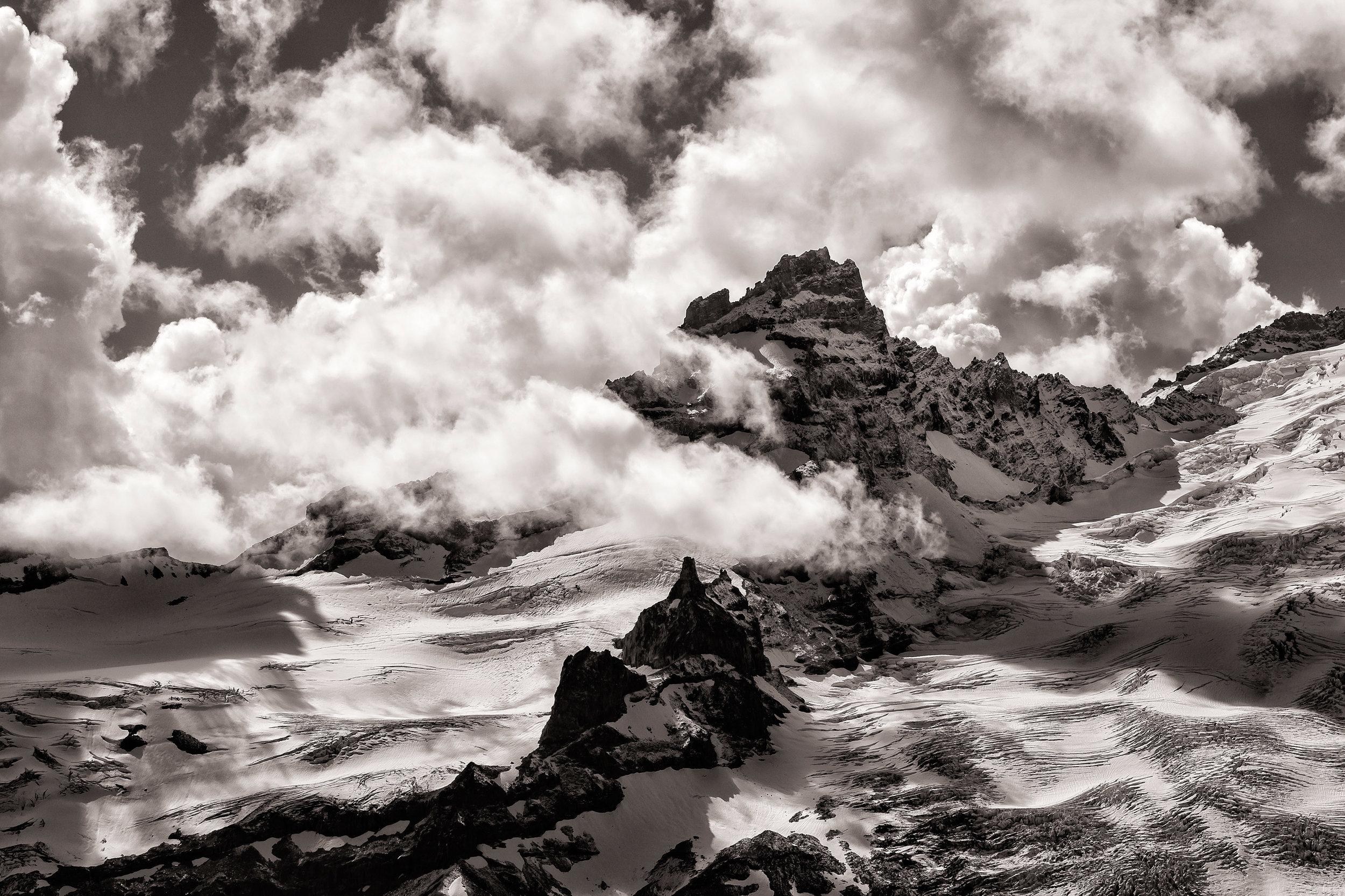 Landscape: Clouds hover around Little Tahoma in early autmn, Mt. Rainier National Park, Washington