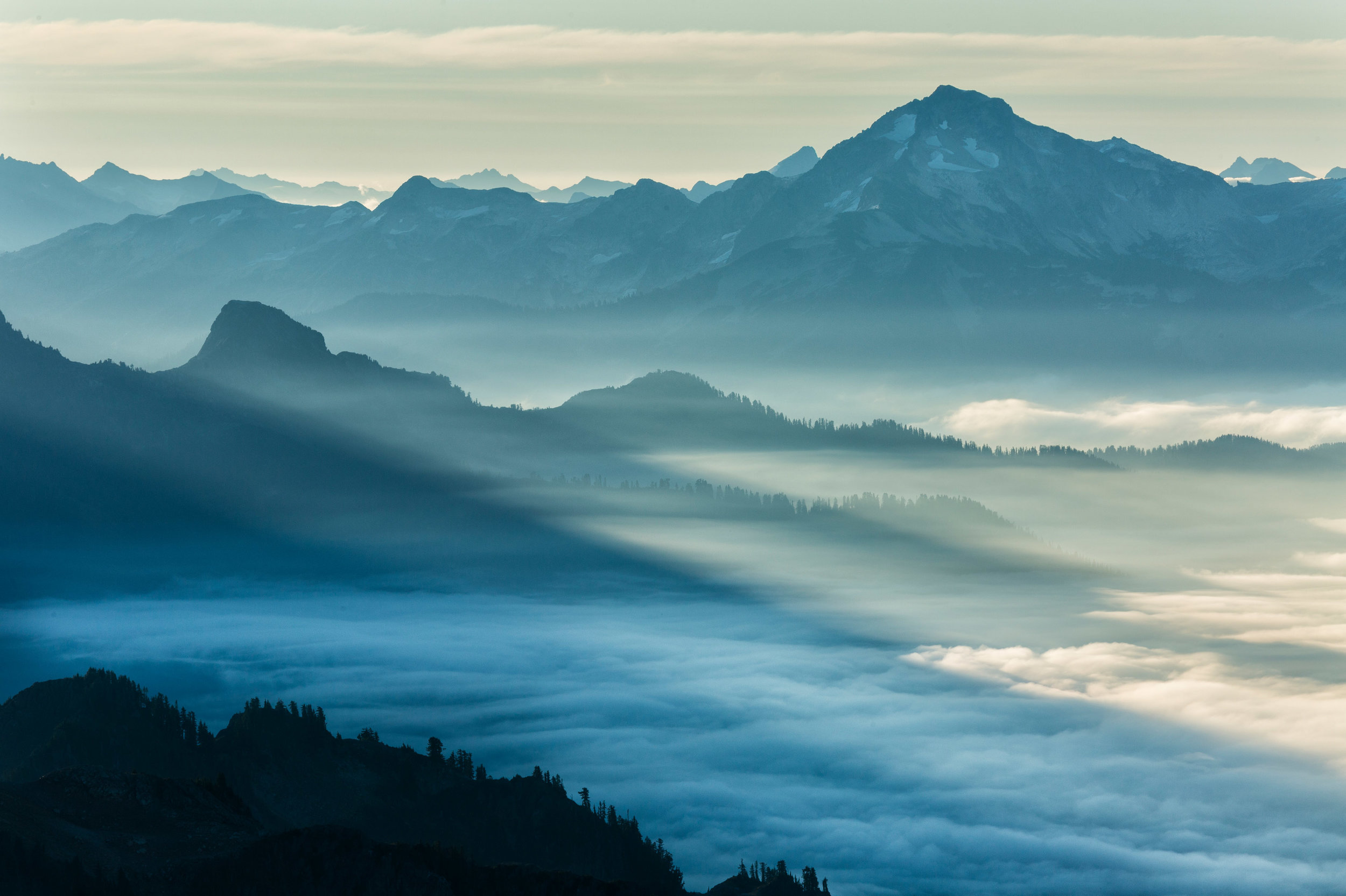 Landscape: Low clouds linger in the valley at sunrise, North Cascades National Park, Washington