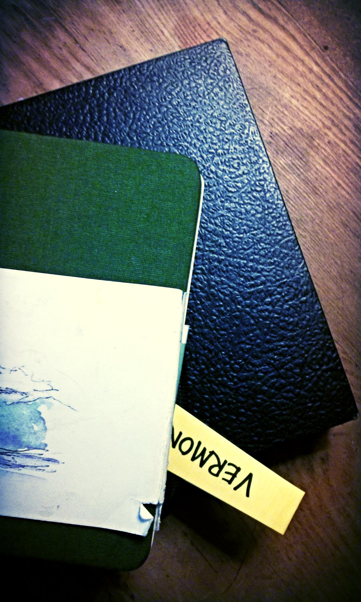 Well-used sketchbooks.