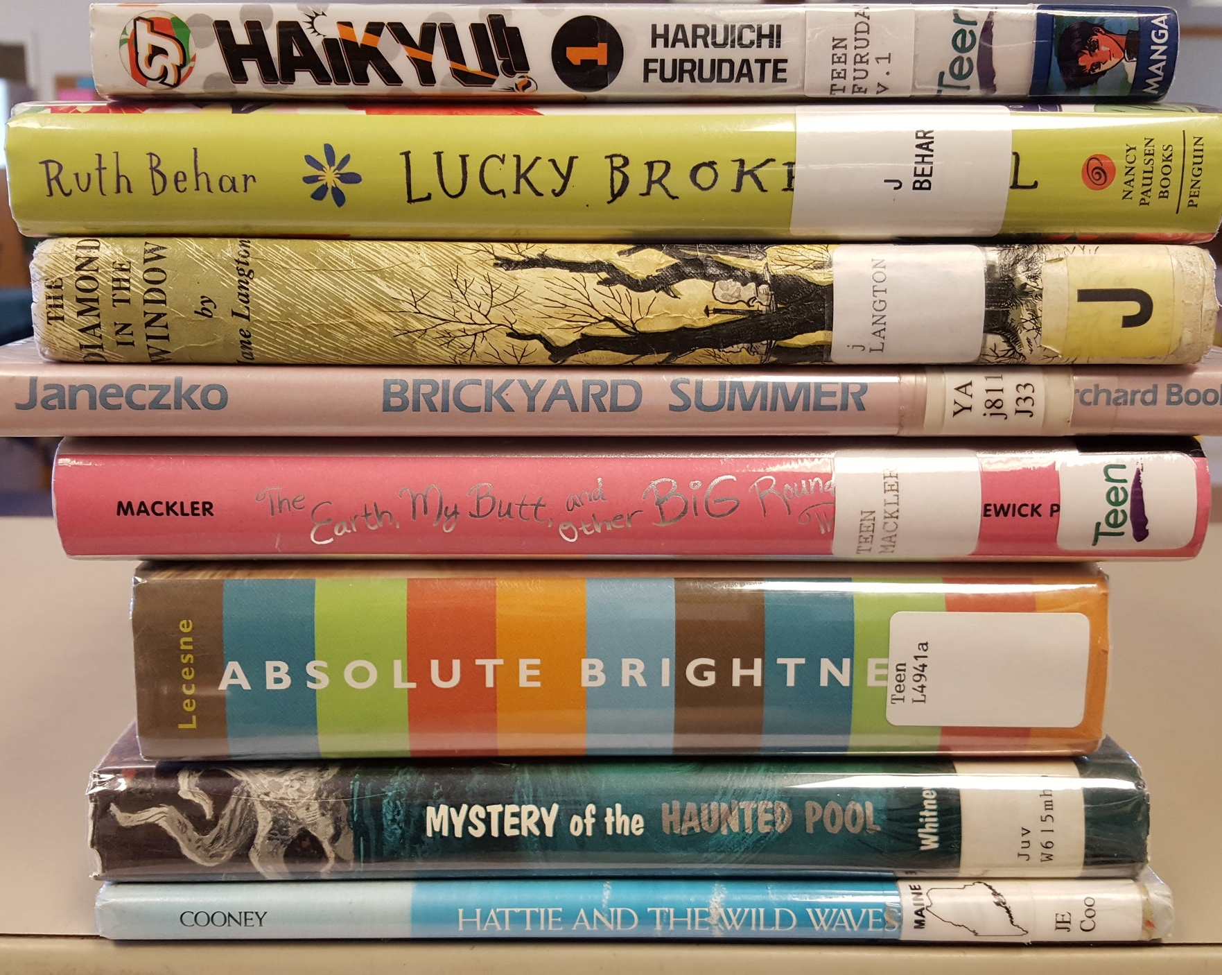 Stack of the eight books listed in this post.
