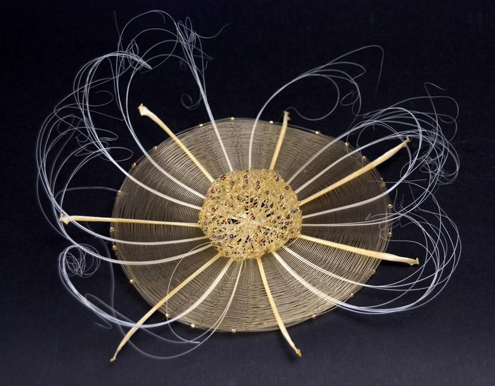 Gerri Johnson-McMillin Champagne Caviar, 2010 Fishbone, champagne monofilament, crocheted mono, gold beads 9 x 9 x 4 inches / 22.9 x 22.9 x 10.2 cm / GJ 3