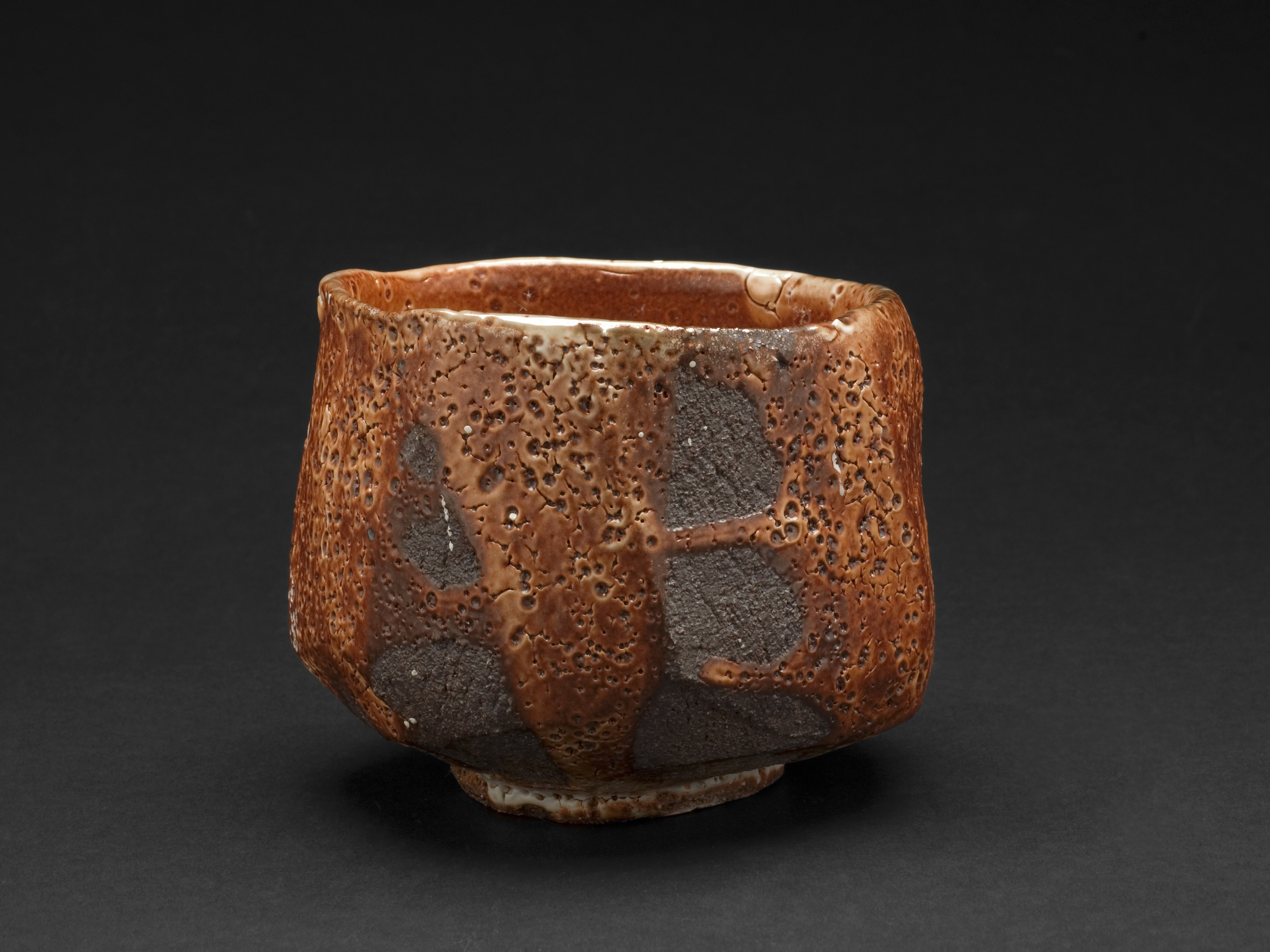 Lisa Hammond    Red Shino Faceted Chawan  , 2013 Crank clay thrown cut and stretched, hand cut foot with red pine knife, fired in reduction, oil fired soda atmosphere to 1300 degree 3.75 x 4.5 inches / 9.5 x 11.4 cm / LHa 5
