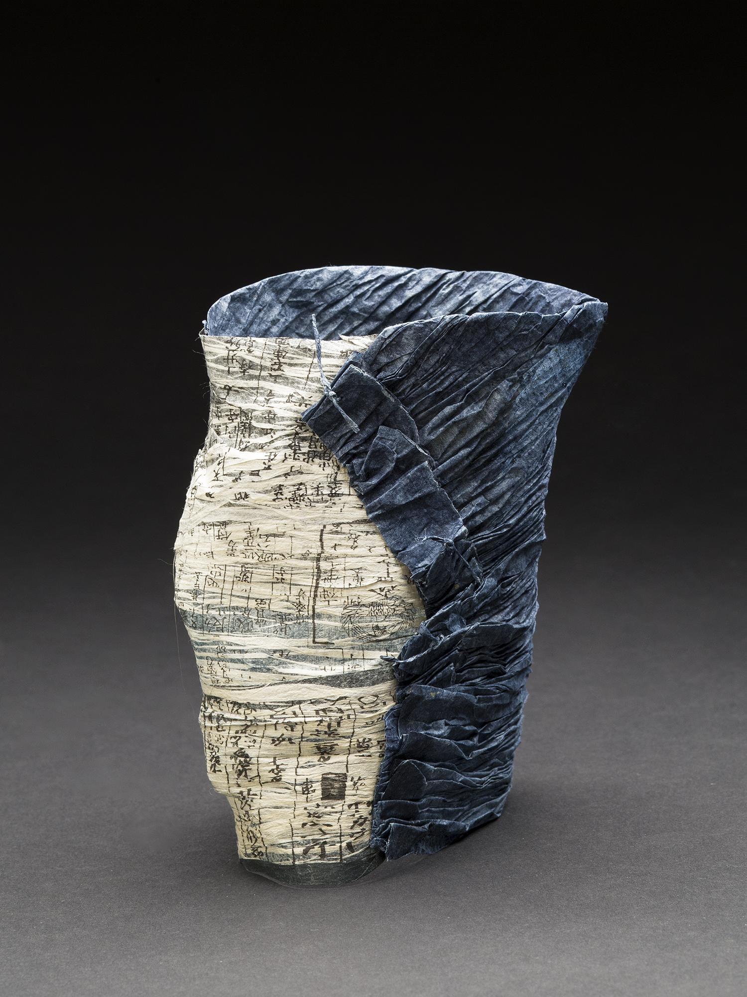 Yuko Kimura    Indigo Shiwa Shiwa No. 8  , 2014 Aquatint, indigo dye on old bookpages and kozo handmade paper, paper thread, Konnyaku ( devil's tongue root starch) 4.5 x 3.25 x 3.25 inches 11.4 x 8.3 x 8.3 cm YuK 30