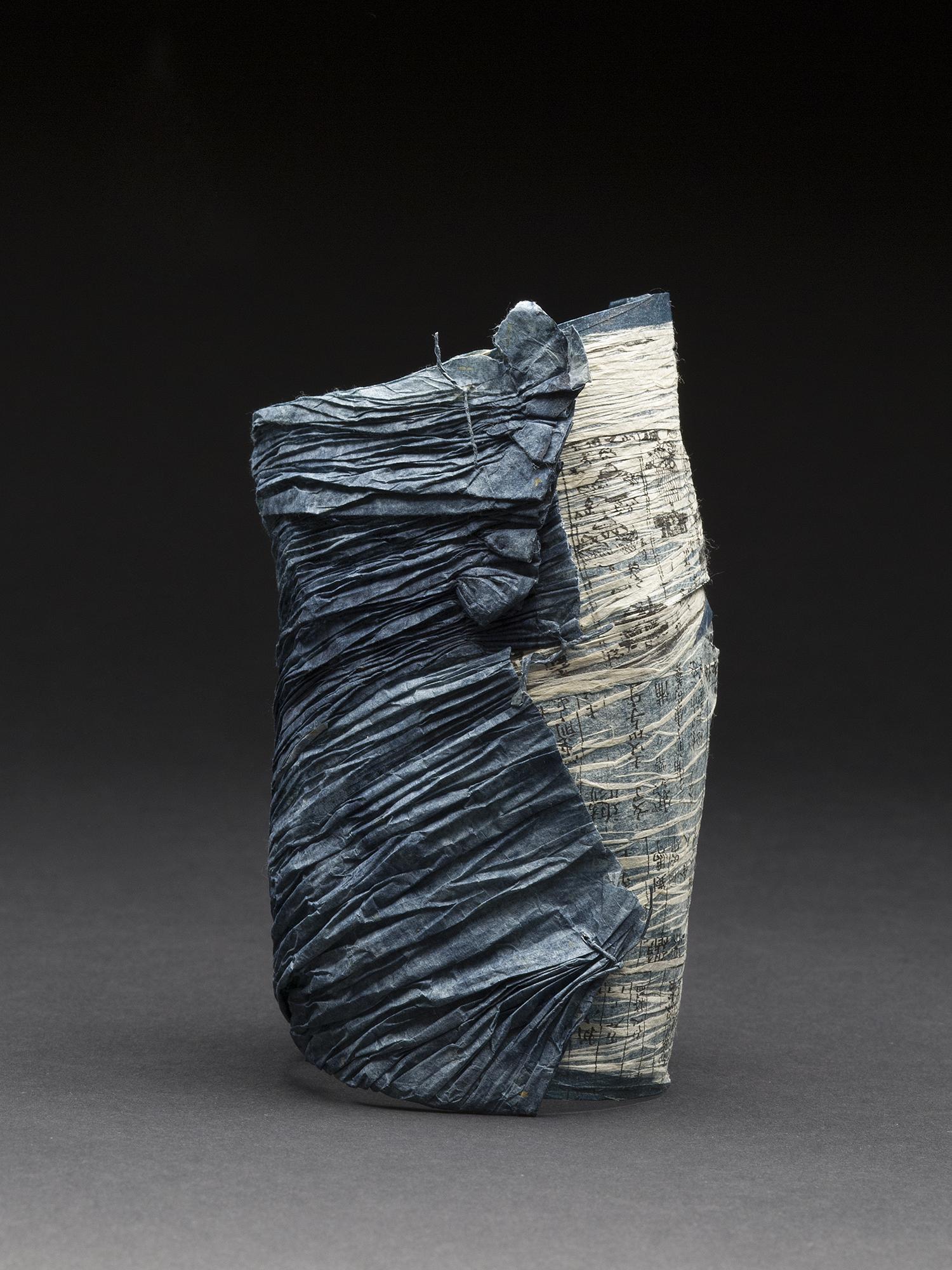 Yuko Kimura    Indigo Shiwa Shiwa No. 7  , 2014 Aquatint, indigo dye on old bookpages and kozo handmade paper, paper thread, Konnyaku ( devil's tongue root starch) 5 x 3 x 2 inches 12.7 x 7.6 x 5.1 cm YuK 29