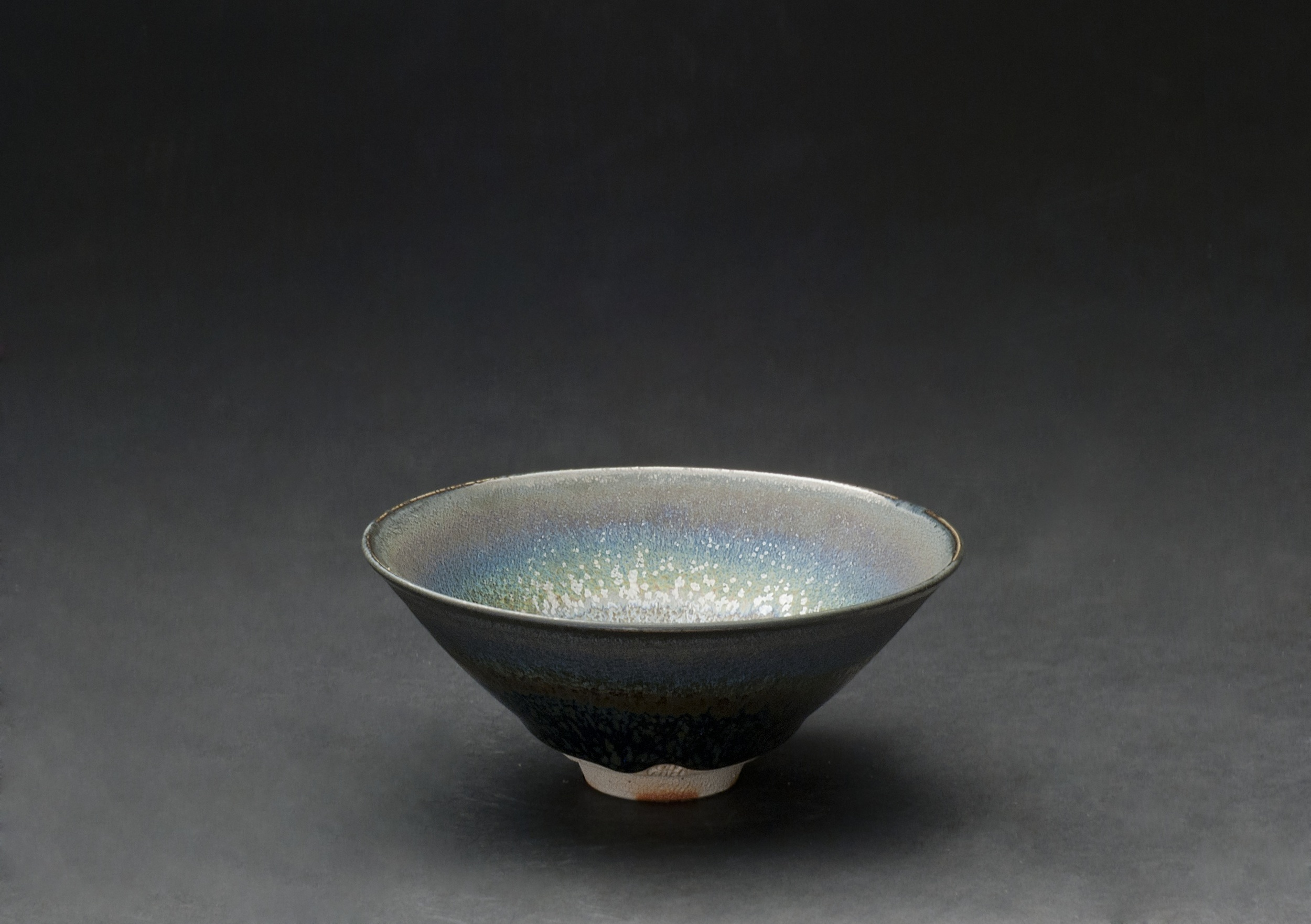 Wasaburo Takahashi    Seiran Tenmoku-yu Chawan  , 2011 Finishing: double dipping with Tenmoku glaze (black colored glaze) and Seiran glaze (blue colored glaze); glaze: Tenmoku-glaze (iron glaze); firing: reduction firing in gas kiln at 1250 C, fired twice 2.5 x 6 inches 6.4 x 15.2 cm WTa 1