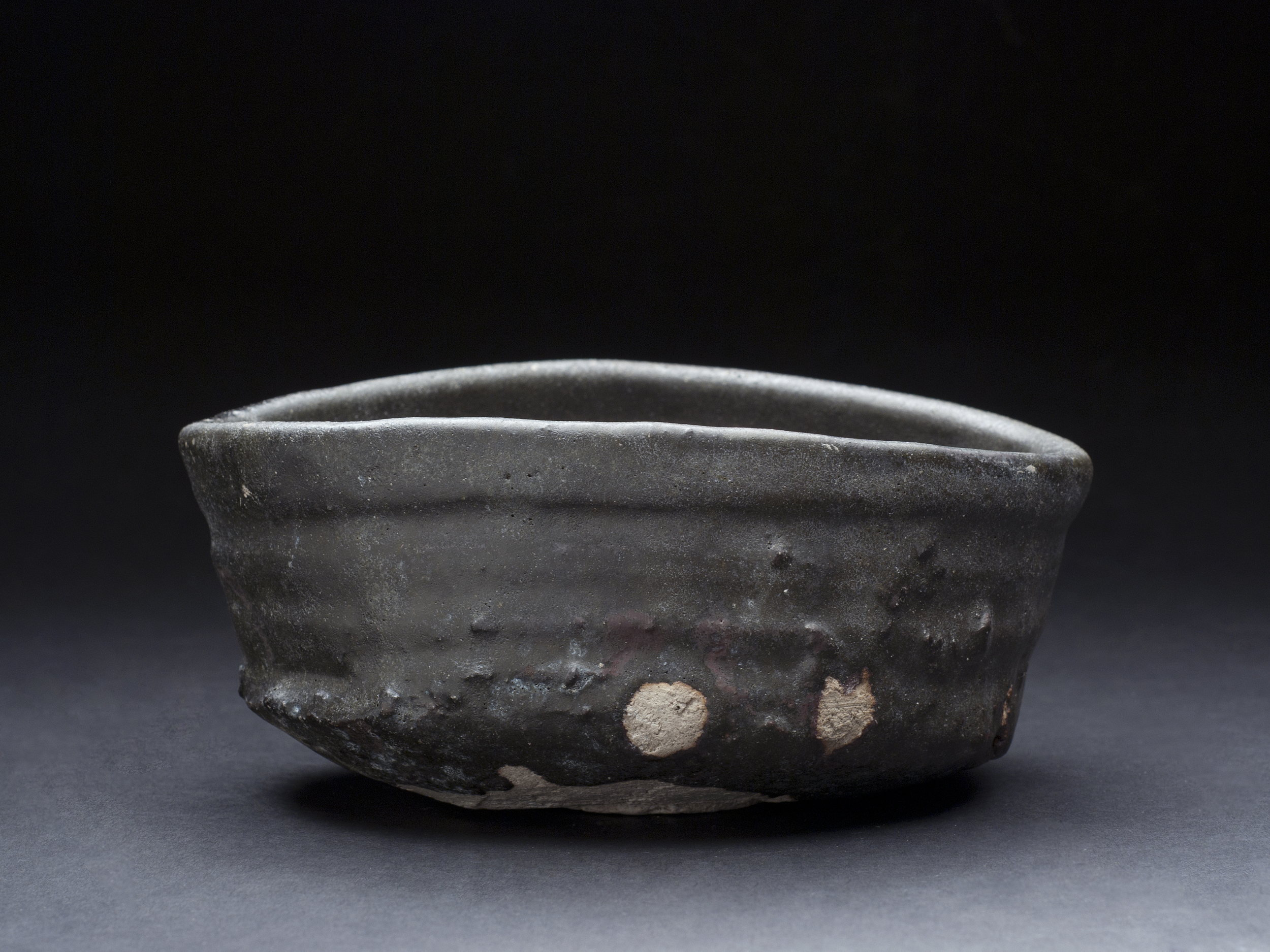 Shiro Tsujimura    Kuro-Oribe Chawan  , 2007 Mixed iron, charcoal (mokutan), Chooseki, etc, and firing with 1300C. And then proceed by rapid cooling, make it become black color 3 x 6.5 inches 7.6 x 16.5 cm STs 2