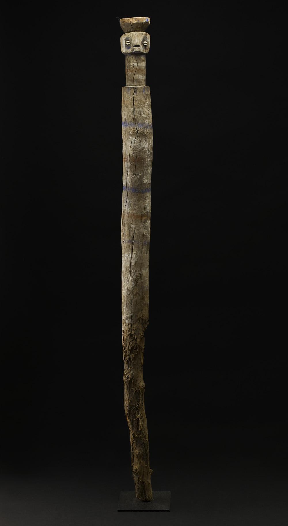 Africa    Bocio - Ewe/Adan People - Togo  , Mid. 20th C. Wood, shells, pigments 55.5 x 3.5 x 3.5 inches 141 x 8.9 x 8.9 cm Af 302