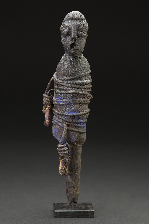 Africa    Bocio - Adja People - Benin/Togo  , Mid. 20th C. Wood, shells, pigment, natural fiber, sacrificial materials 10 x 2.5 x 2.5 inches 25.4 x 6.4 x 6.4 cm Af 310