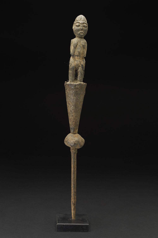 Africa    Bocio - Fon People - Benin  , Mid. 20th C. Wood, iron, sacrificial materials 19 x 3 x 2.5 inches 48.3 x 7.6 x 6.4 cm Af 325