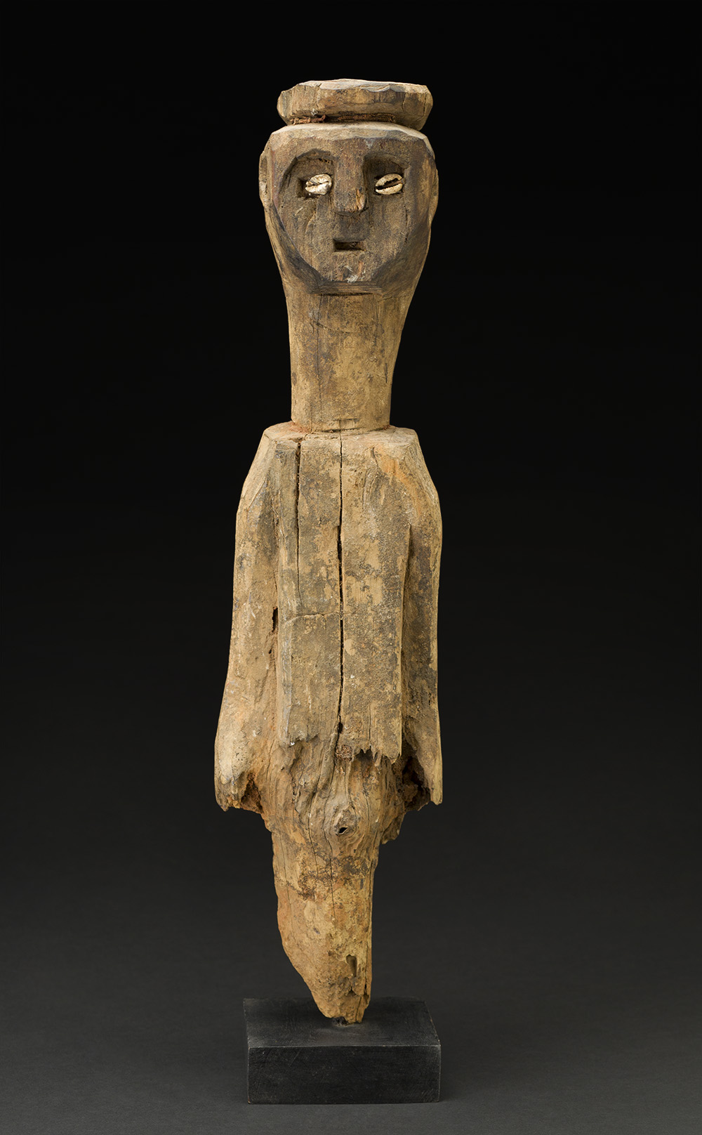 Africa    Bocio - Ewe People - Togo  , Mid. 20th C. Wood, shells, natural materials 19 x 5 x 3 inches 48.3 x 12.7 x 7.6 cm Af 330