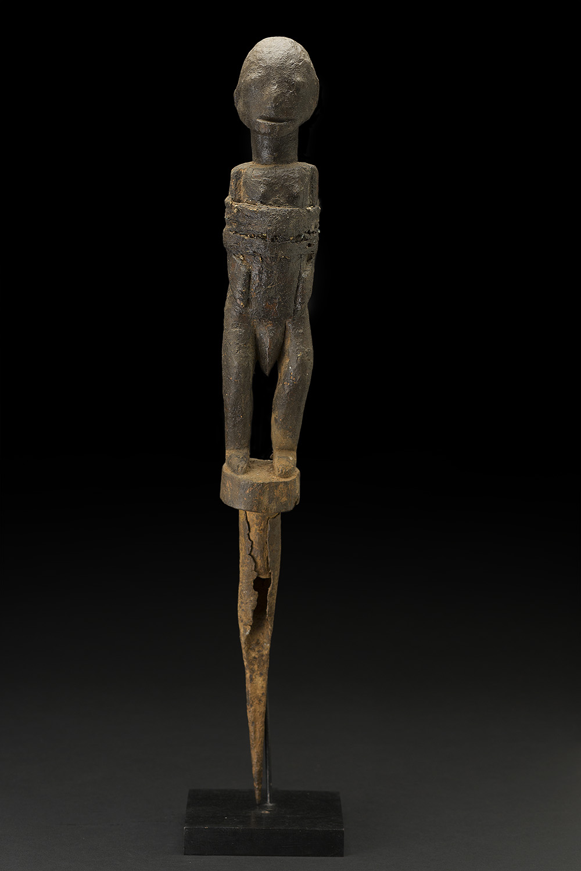 Africa    Bocio - Fon People - Benin  , Mid. 20th C. Wood, metal, fabric, string, sacrificial materials 22.5 x 3 x 3 inches 57.2 x 7.6 x 7.6 cm Af 331