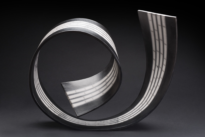 Simcha Even-Chen    Spiral Flow I  , 2014 Slab-built, burnished, terra sigillata, Naked Raku 13 x 16 x 6 inches 33 x 40.6 x 15.2 cm SEC 4