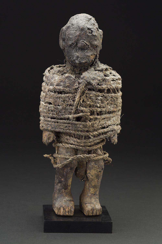 Africa    Vodun Sculpture - Adja People - Benin  , Mid. 20th C. Wood, metal, fiber, sacrificial materials 10.5 x 4 x 3.5 inches 26.7 x 10.2 x 8.9 cm Af 307