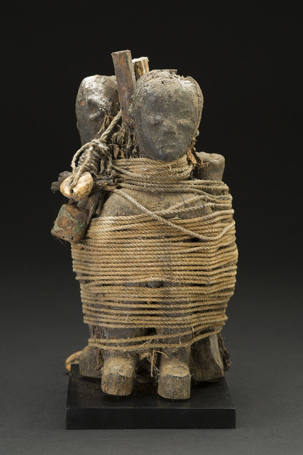 Africa    Vodun Sculpture - Ewe People - Togo  , Mid. 20th C. Wood, string, bone, shells, nails, padlocks, pigment, iron, feathers, patina, and sacrificial materials 8 x 5.25 x 4 inches 20.3 x 13.3 x 10.2 cm Af 317