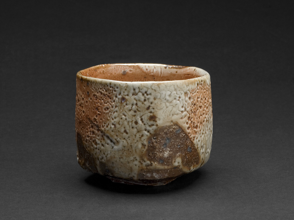 Lisa Hammond    Red Shino Faceted Chawan  , 2013 Crank clay thrown cut and stretched, hand cut foot with red pine knife, fired in reduction, oil fired soda atmosphere to 1300 degree 3.5 x 4.25 inches 8.9 x 10.8 cm LHa 6